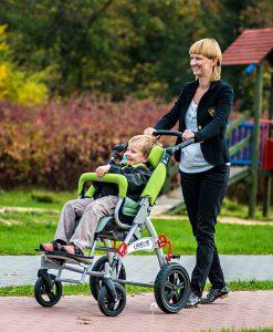 Специальная коляска (кресло-коляска инвалидная) URSUS с ребенком